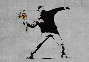 bansky flower brick thrower 1 300x210 1